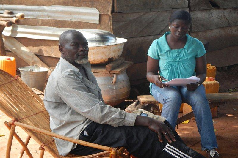 Enumerator and farmer in Ghana.jpg